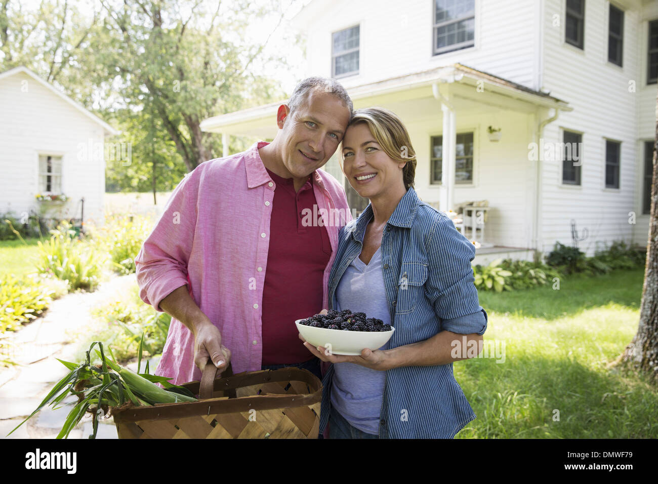 A family summer garing at a farm. A shared meal a homecoming. Stock Photo