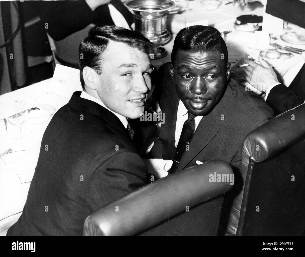 Apr. 7, 1961 - London, England, U.K. - DAVE CHARNLEY was an English lightweight boxer. Known as 'The Dartford Destroyer' the left-handed Charnley had a 10 year career lasting from 1954 to 1964. He won bronze in the 1954 Commonwealth Games in Vancouver, Canada. PICTURED: DAVE CHARNLEY, left, with world lightweight champ JOE BROWN, of the USA, at Isow's Restaurant. (Credit Image: © K - Stock Image