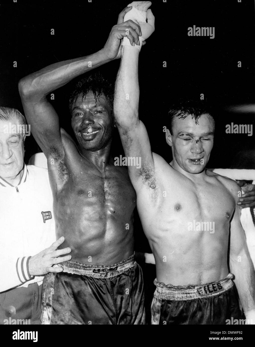 April 18, 1961 - London, England, U.K. - Boxer JOE BROWN is an African American world lightweight champion, he retained is title in a gruelling contest against DAVE CHARNLEY which he won on points at Earls Court. PICTURED: The two fighters after the match. (Credit Image: © KEYSTONE Pictures USA/ZUMAPRESS.com) - Stock Image