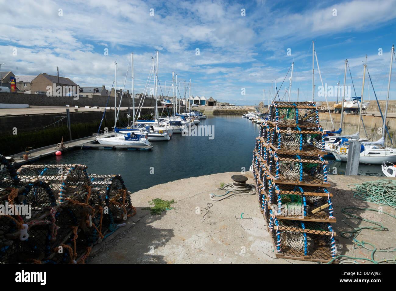 pier lossiemouth harbour creels marina moray coast - Stock Image