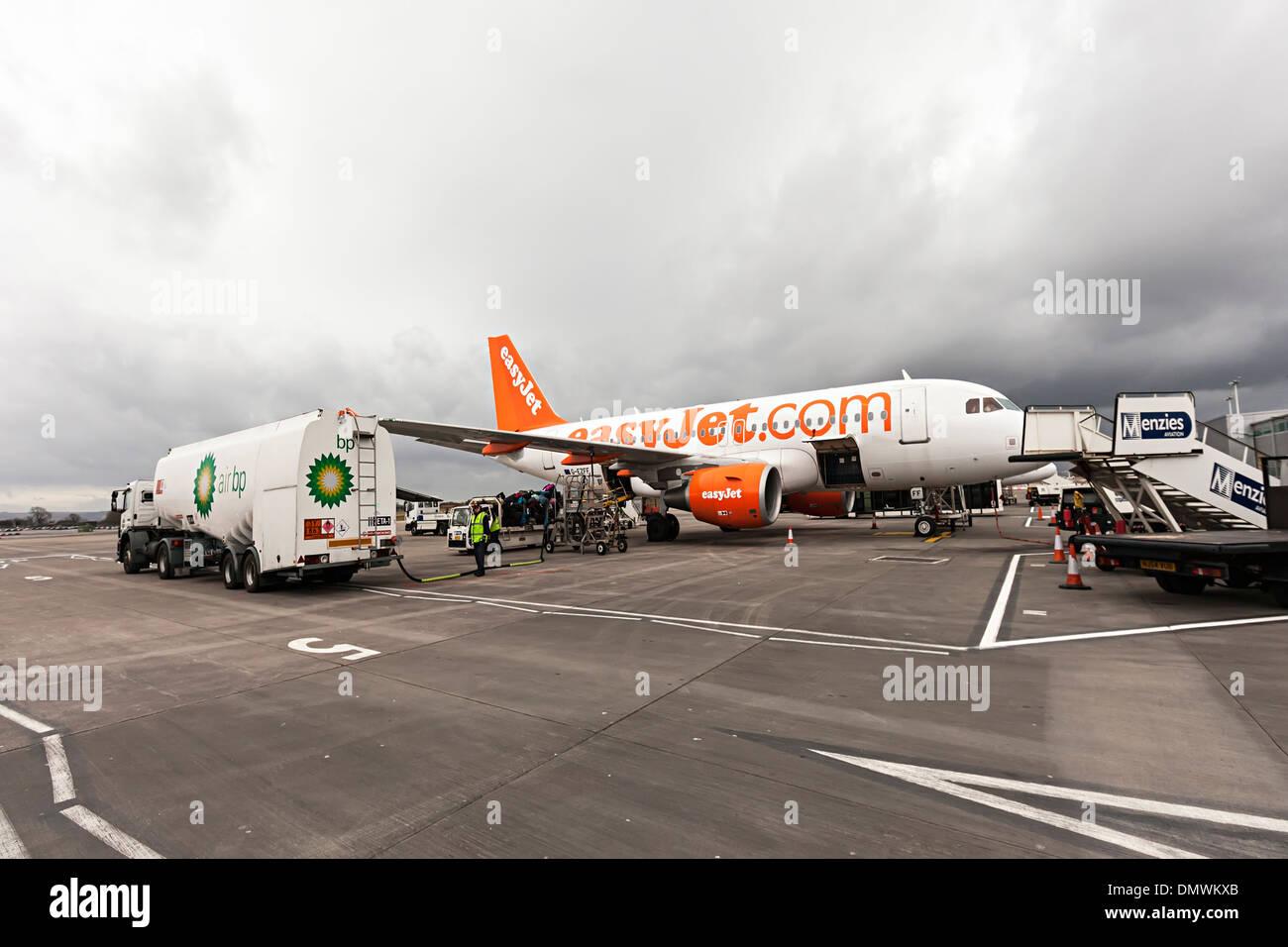 Easyjet aeroplane being refuelled on tarmac, Bristol airport, England, UK - Stock Image