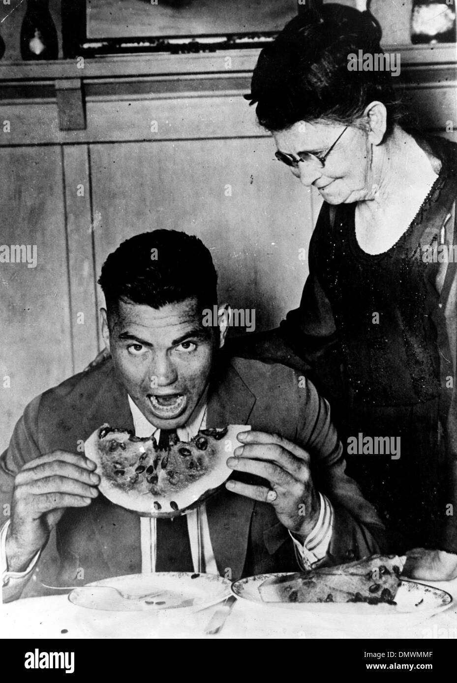 Aug. 5, 1945 - Manassa, CO, U.S. - JACK DEMPSEY with mother eating watermelon. Jack 'Manassa Mauler' Dempsey (June 24, 1895 - May 31, 1983) was an American boxer who held the world heavyweight title from 1919 to 1926. Dempsey's aggressive style and punching power made him one of the most popular boxers in history. Many of his fights set financial and attendance records. (Credit Ima - Stock Image