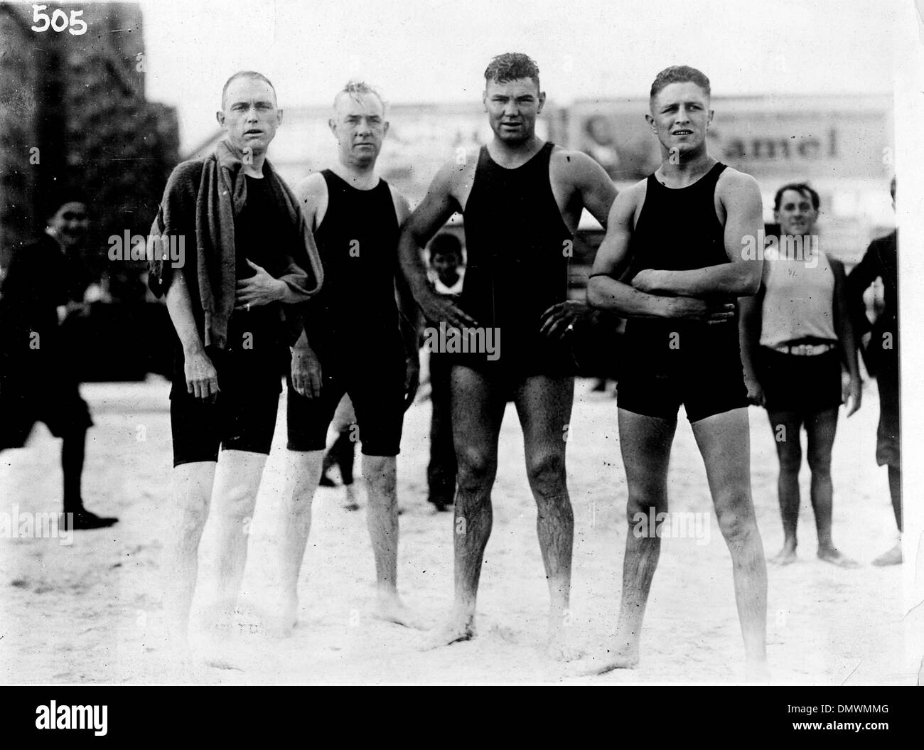 Aug. 5, 1945 - New York, NY, U.S. - JACK DEMPSEY (C) with friends at beach. Jack 'Manassa Mauler' Dempsey (June 24, 1895 - May 31, 1983) was an American boxer who held the world heavyweight title from 1919 to 1926. Dempsey's aggressive style and punching power made him one of the most popular boxers in history. Many of his fights set financial and attendance records. FILE: c. 1920- - Stock Image
