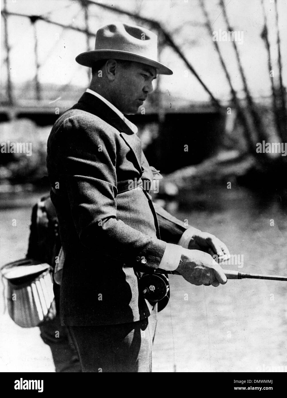 Aug. 5, 1945 - Manassa, CO, USA - JACK DEMPSEY fishing on the Colorado River. Jack 'Manassa Mauler' Dempsey (June 24, 1895 – May 31, 1983) was an American boxer who held the world heavyweight title from 1919 to 1926. Dempsey's aggressive style and punching power made him one of the most popular boxers in history. Many of his fights set financial and attendance records.  (Credit Ima - Stock Image
