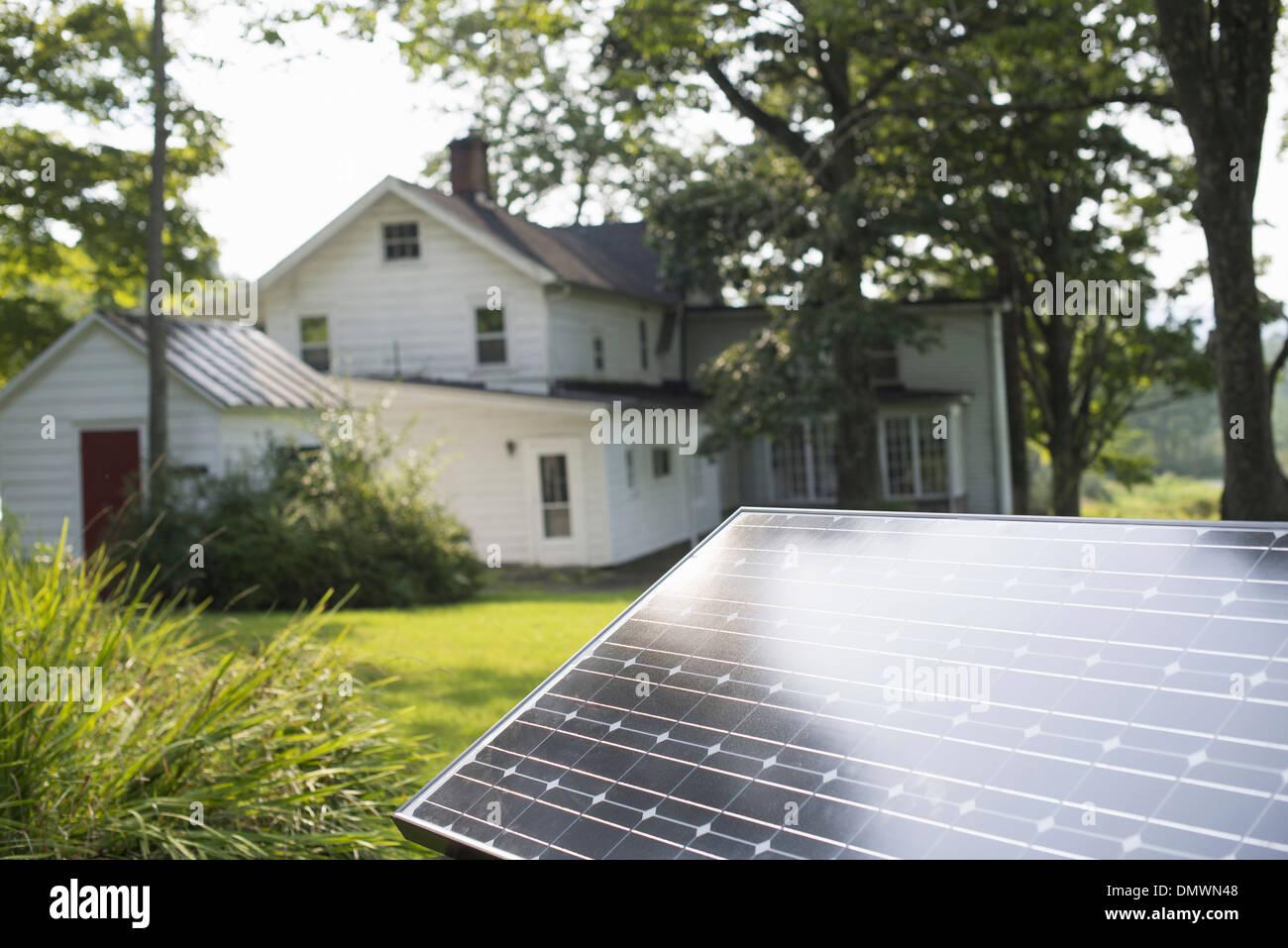 A solar panel in a farmhouse garden. Stock Photo
