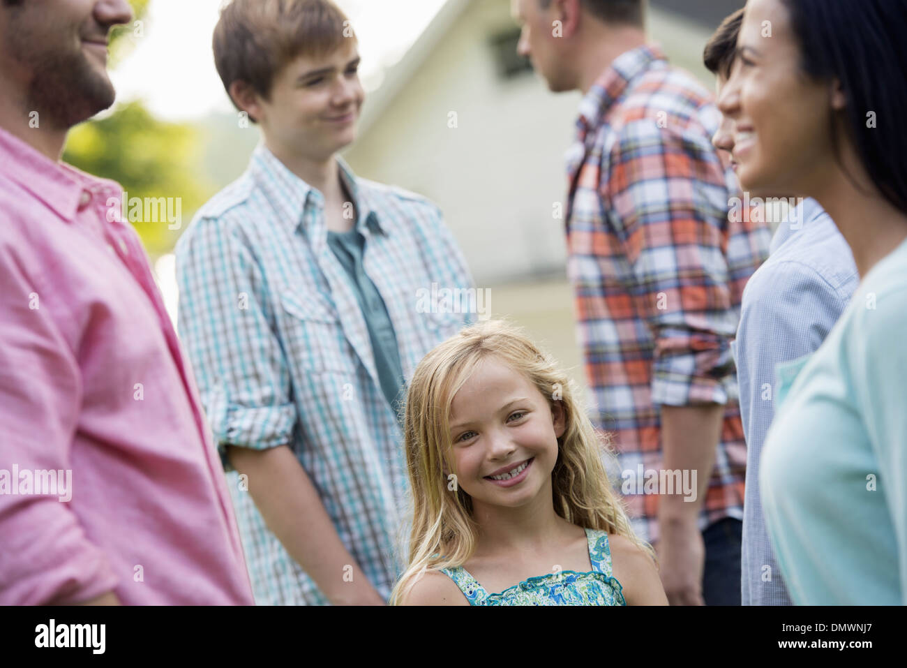 group of people adults and teenagers summer party. - Stock Image