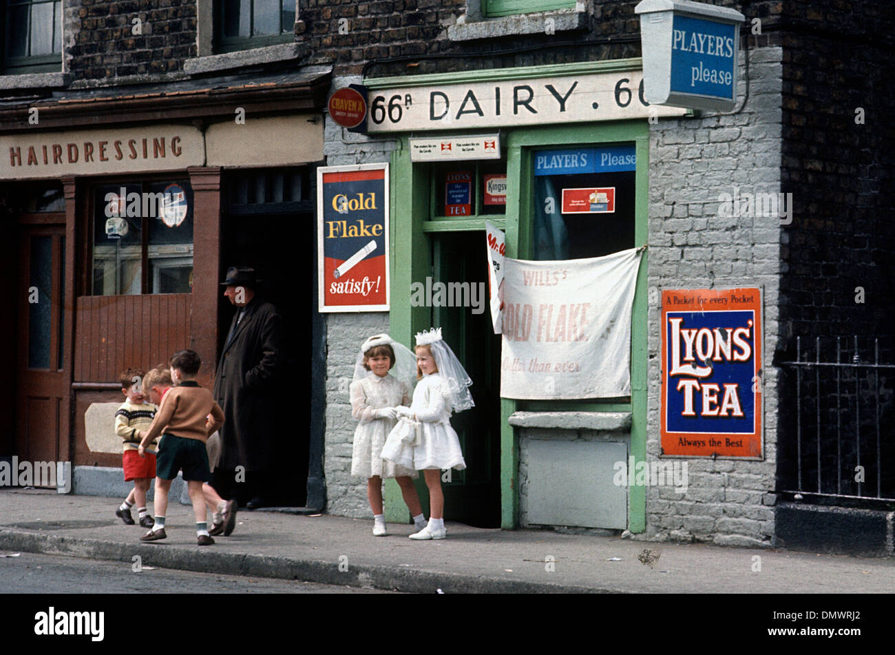 Ireland Dublin First Communion Girls  at a sweet & Dairy shop i960's - Stock Image