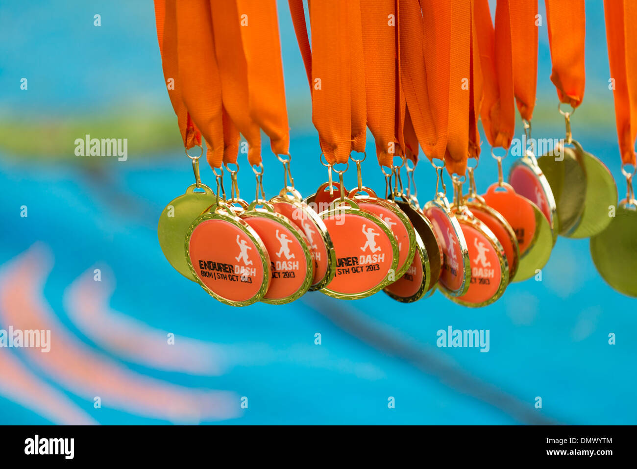 Row of bright orange and gold medal with orange ribbons for Stock