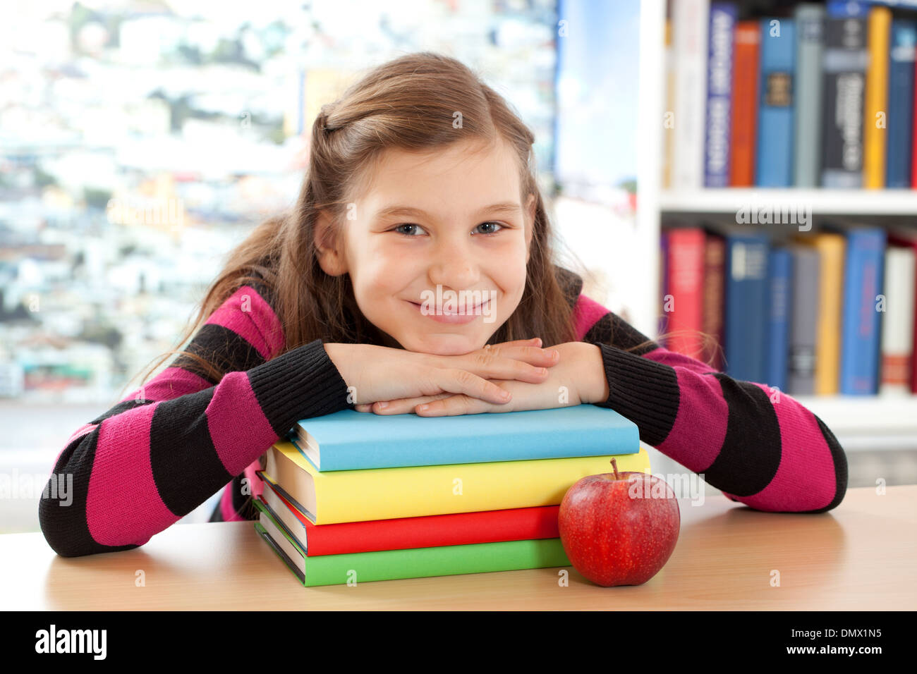 A girl takes a short break at school - Stock Image