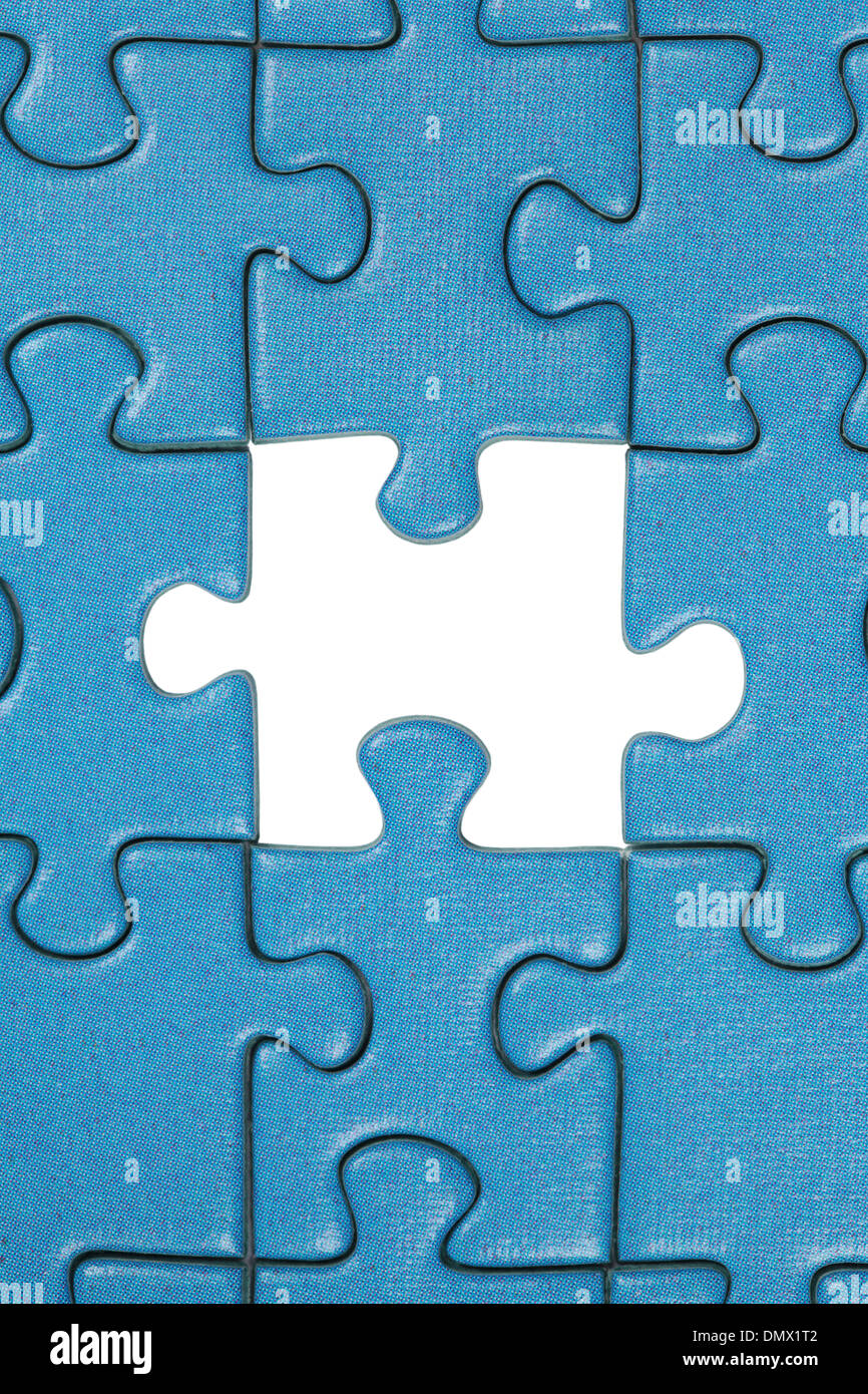 A jigsaw puzzle with the a missing piece - Stock Image