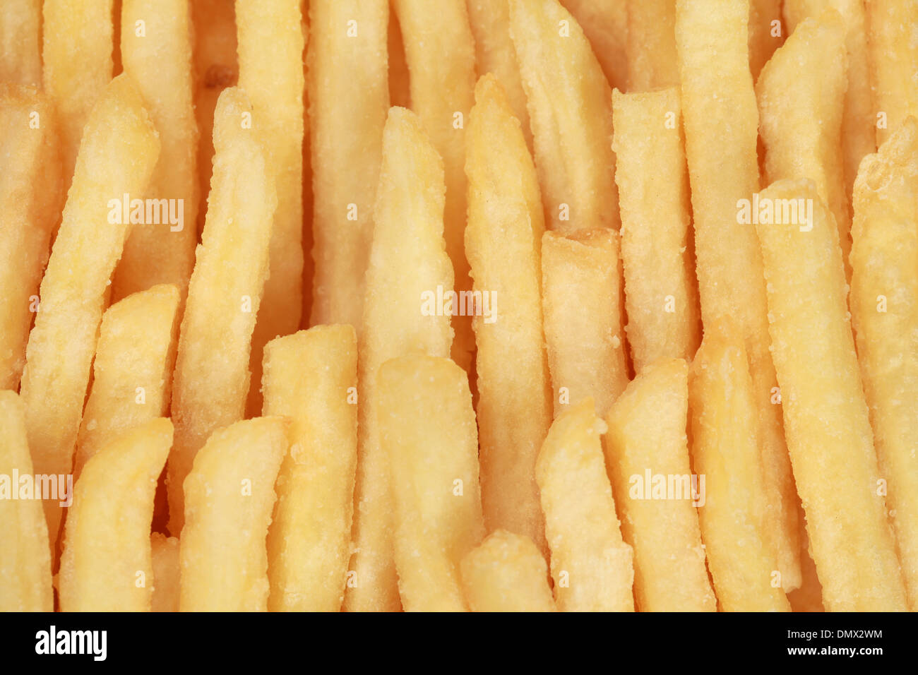 French fries forming a fast food background - Stock Image
