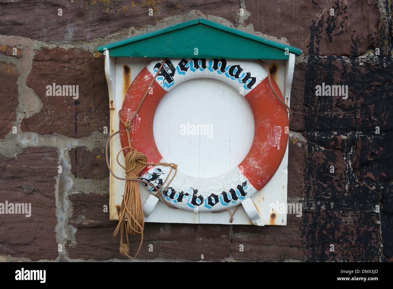 life saver ring pennan harbour wall - Stock Image