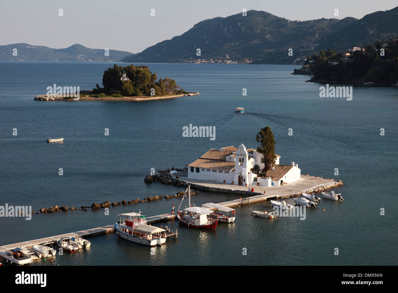 View over the Vlacheraina monastery and mouse island on Corfu in Greece before sunset. - Stock Image