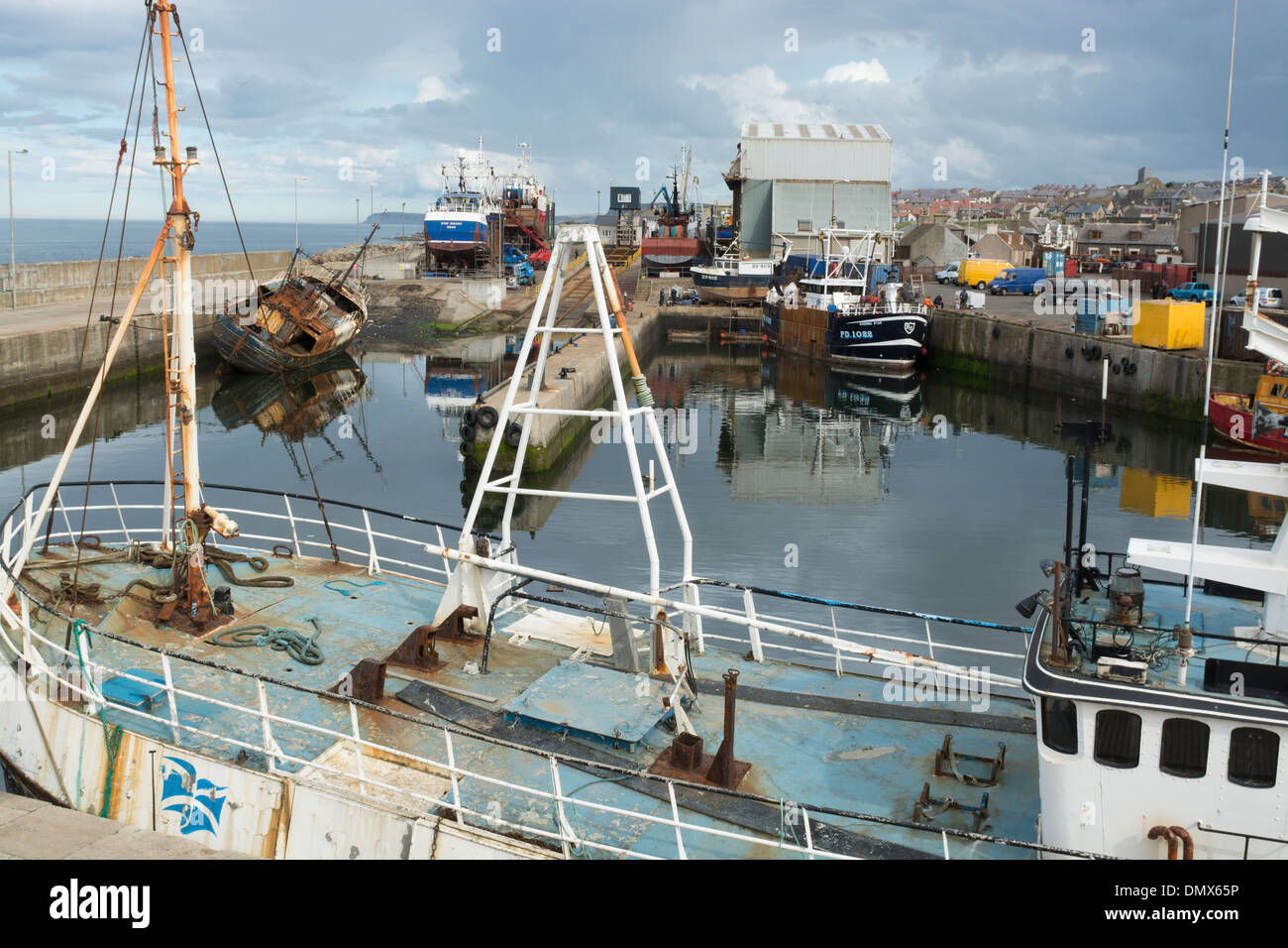 commercial fishermen boats nets harbour macduff - Stock Image
