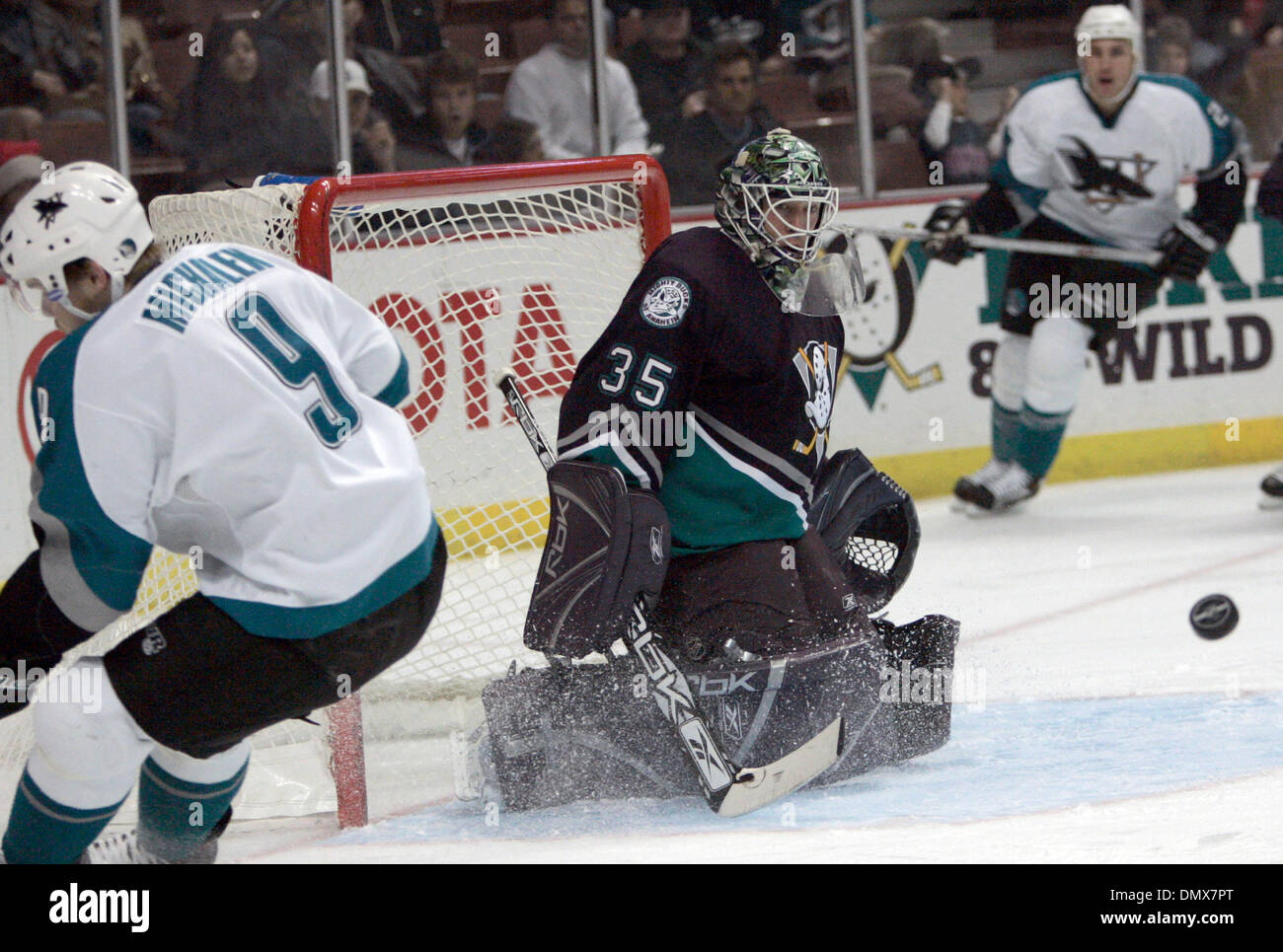 Dec 18, 2005; Anaheim, CA, USA; Mighty Ducks  goalie (35) Jean-Sebastian Giguere (R) makes a save against the San Jose Sharks (9) Milan Michalek  during the first period of their game at the ArrowHead Pound in Anaheim , California. Mandatory Credit: Photo by Armando Arorizo/ZUMA Press. (©) Copyright 2005 by Armando Arorizo - Stock Image