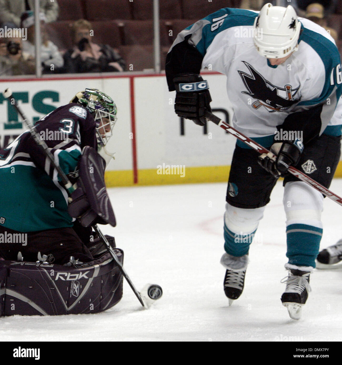 Dec 18, 2005; Anaheim, CA, USA; Mighty Ducks  goalie (35) Jean-Sebastian Giguere (R) makes a save against the San Jose Sharks (16) Mark Smith  during the first period of their game at the ArrowHead Pound in Anaheim , California. Mandatory Credit: Photo by Armando Arorizo/ZUMA Press. (©) Copyright 2005 by Armando Arorizo - Stock Image
