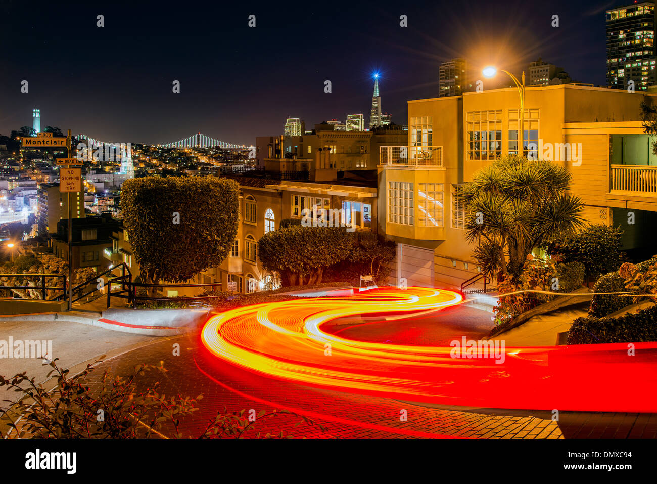 Blurred car light trails at night in Lombard Street, San Francisco, California, USA - Stock Image