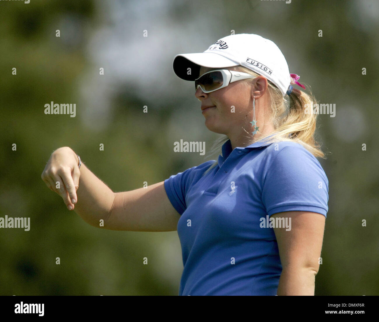 Feb 15, 2006; Oahu, HI, USA; Morgan Pressel gestures after hitting her ball during Wednesday's SBS Open Turtle Bay Resort Official Pro-Am, held on the North Shore in Oahu, Hawaii. Mandatory Credit: Photo by Libby Volgyes/Palm Beach Post/ZUMA Press. (©) Copyright 2006 by Palm Beach Post - Stock Image