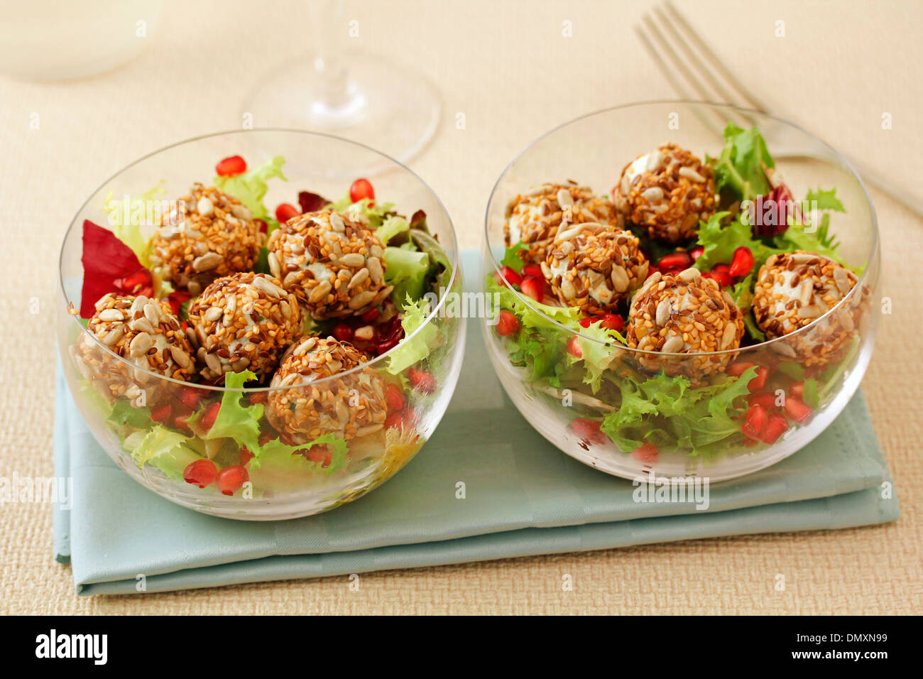 Salad with cheese balls and seeds. Recipe available. - Stock Image