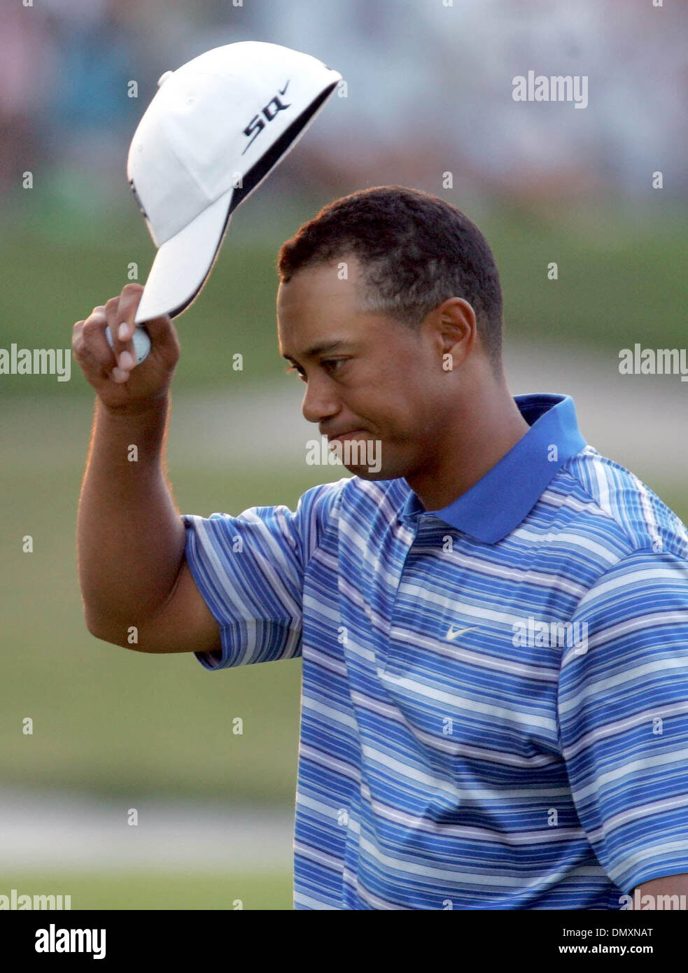 Mar 04, 2006; Miami, FL, USA; Tiger Woods tips his hat after completeing the third round. Mandatory Credit: Photo Stock Photo