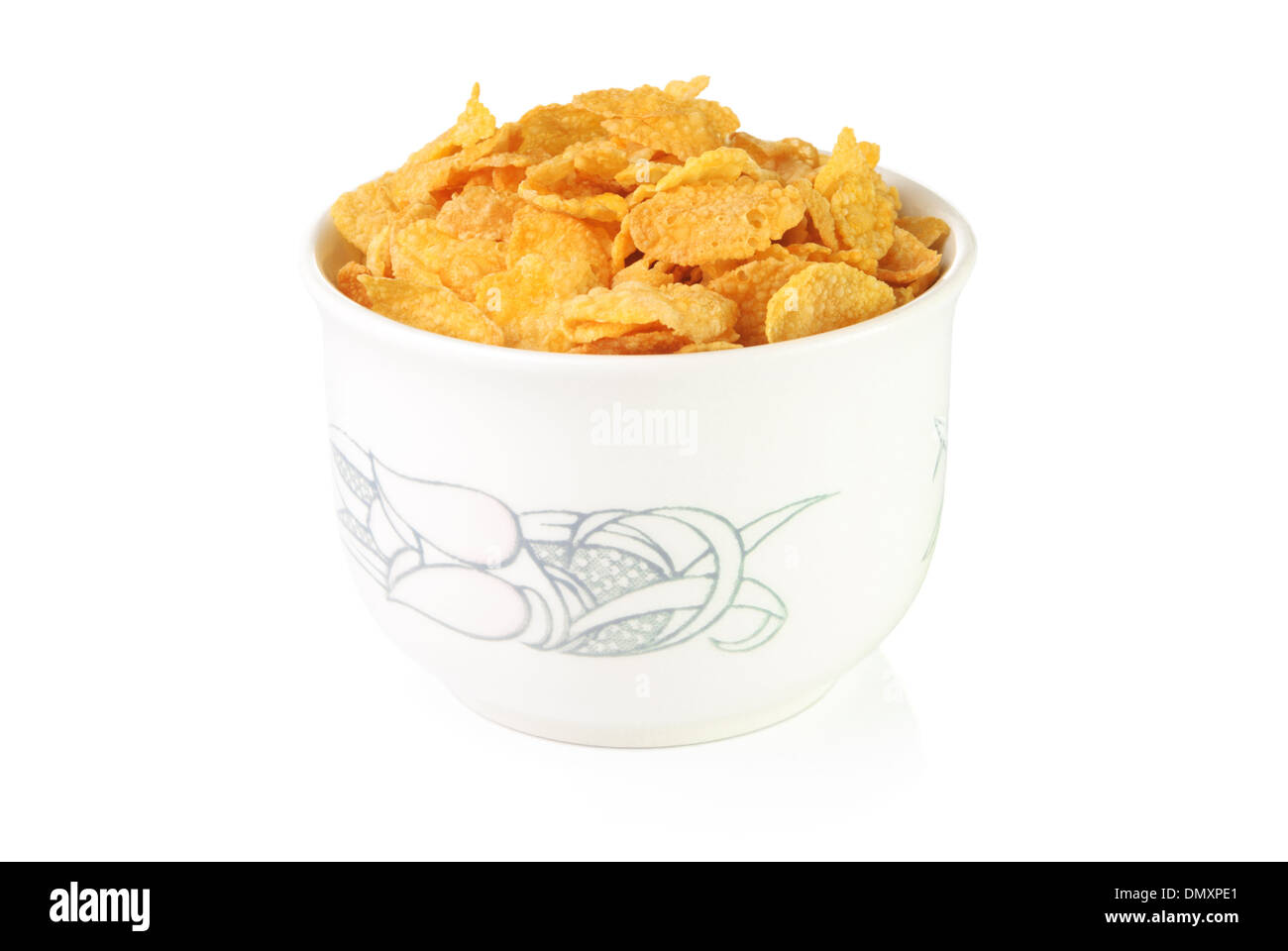 Corn flakes in a bowl on white background - Stock Image