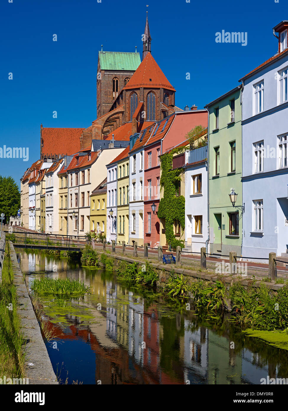 Muehlengrube River with St. Nicholas Church in Wismar, Mecklenburg-Vorpommern, Germany - Stock Image