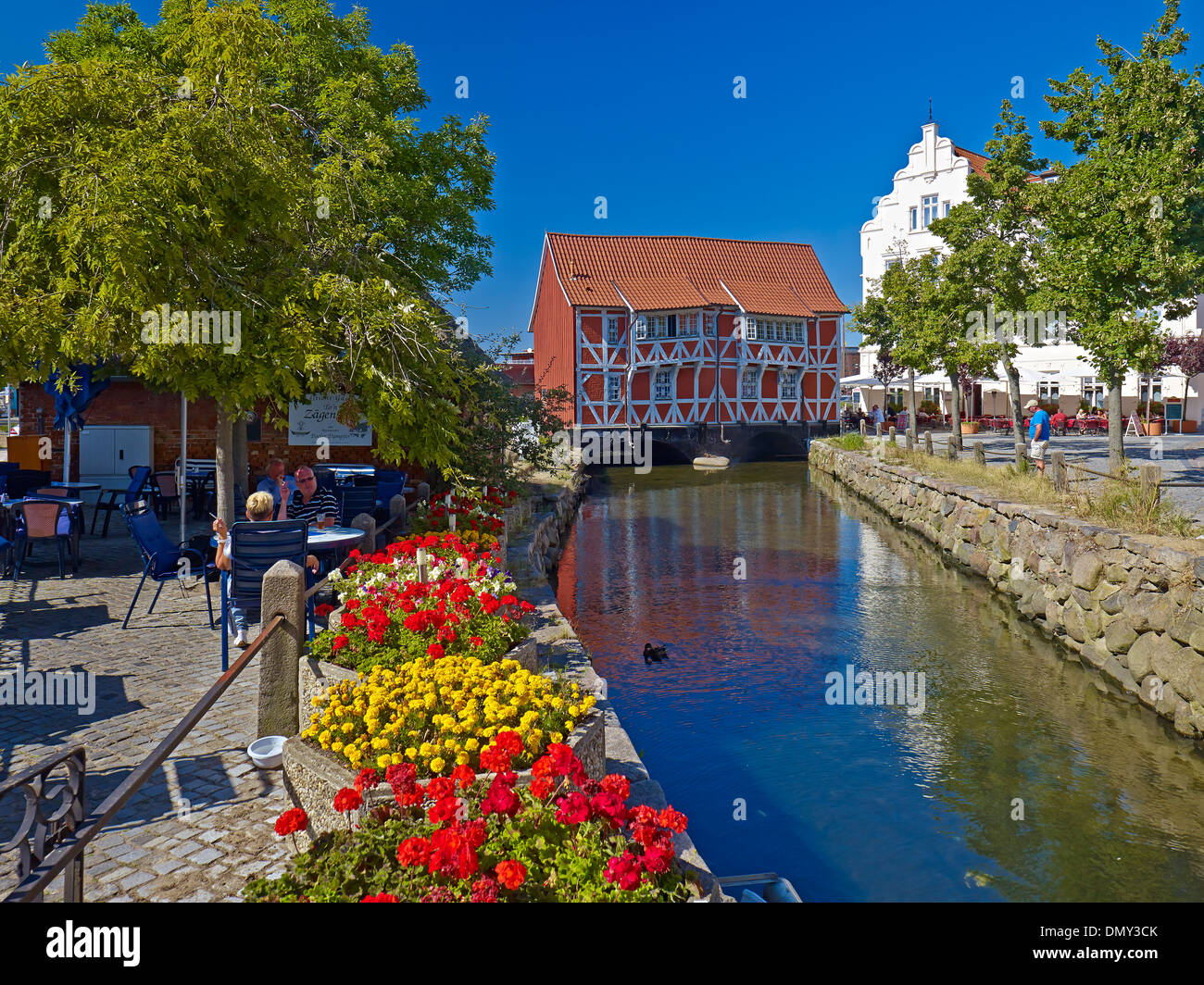 Half-timbered house Gewoelbe with Grube River, Hanseatic city of Wismar, Mecklenburg-Vorpommern, Germany - Stock Image