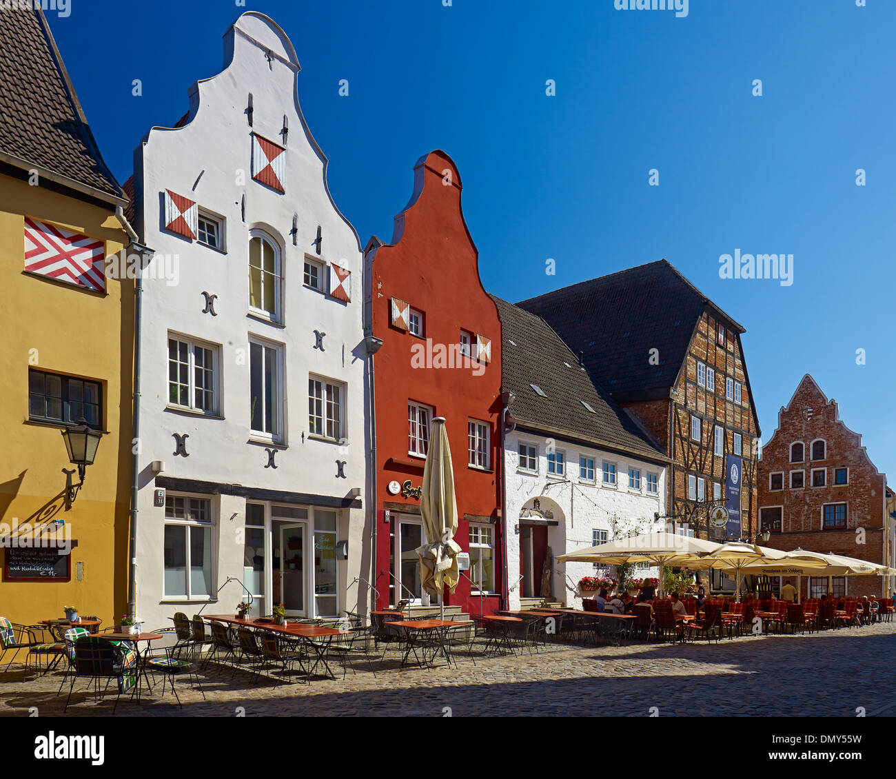 Houses with restaurants at the Lohberg, Hanseatic city of Wismar, Mecklenburg-Vorpommern, Germany - Stock Image