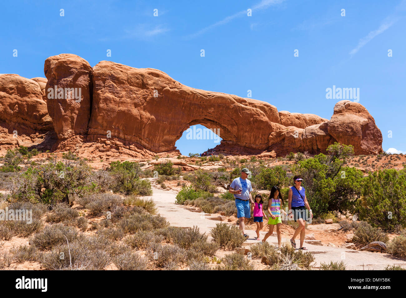 Tourists at North Window arch, The Windows Section, Arches National Park, Utah, USA - Stock Image