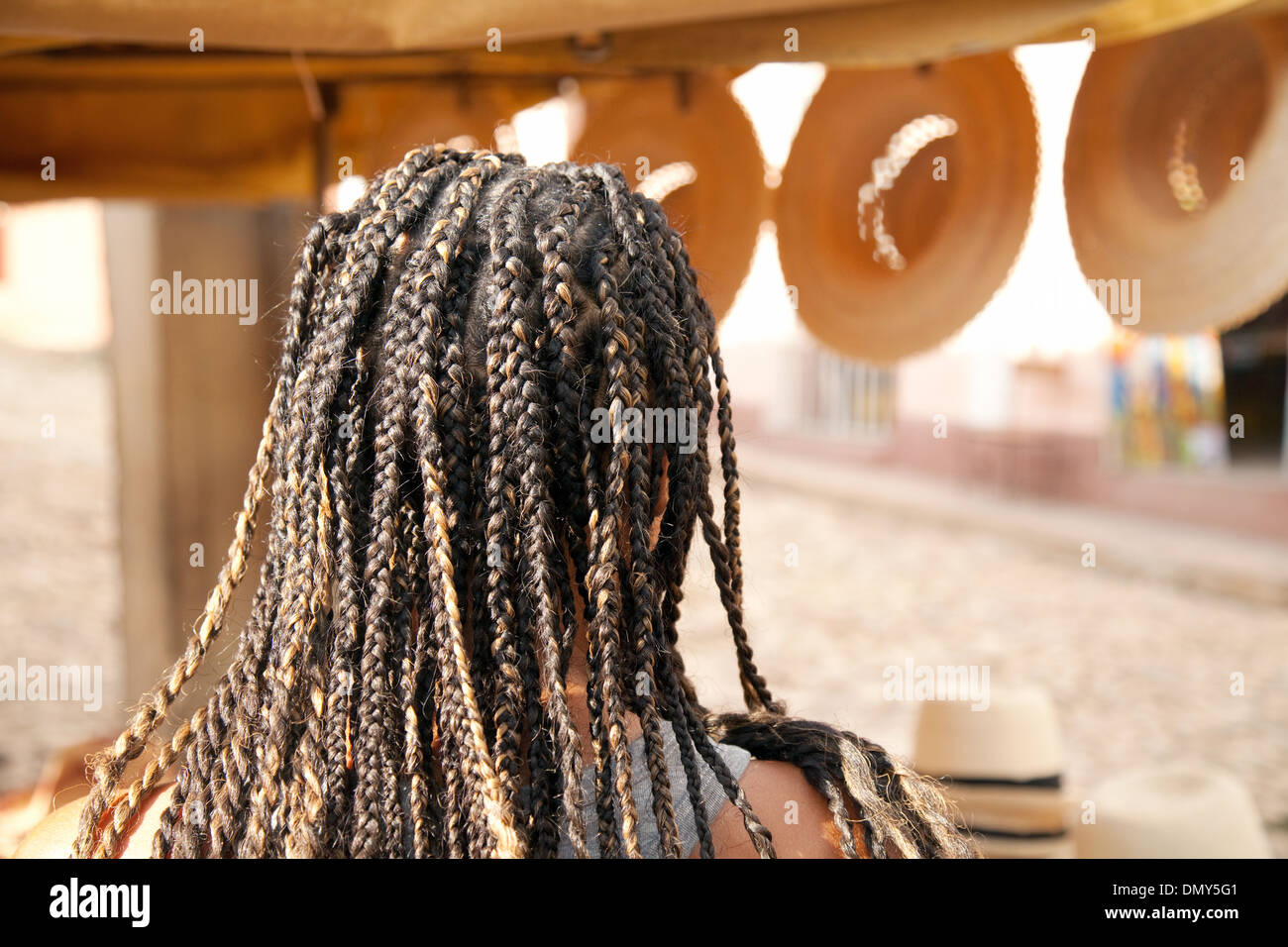 A young woman with braided hair braids, example of local culture, Cuba, Caribbean, Latin America - Stock Image