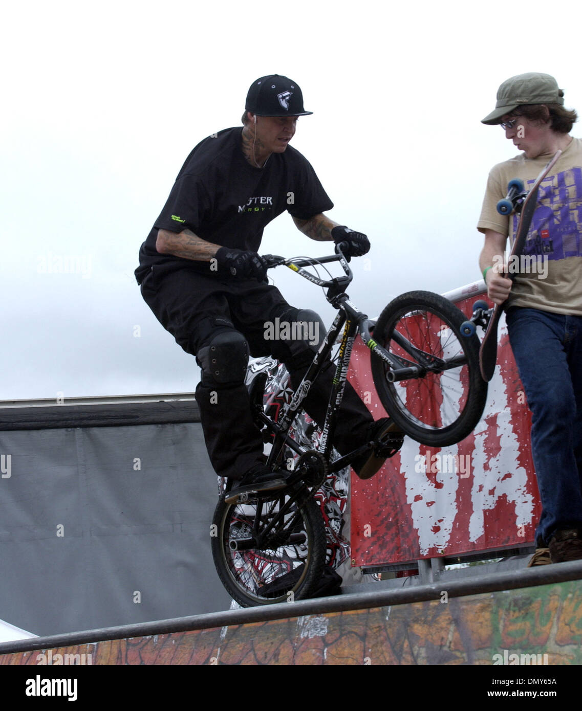 Jun 27, 2006; Raleigh, NC, USA; A person rides a bicycle on a half pipe ramp at the 2006 Vans Warped Tour makes a stop at Alltel Pavilion located in Raleigh. Mandatory Credit: Photo by Jason Moore/ZUMA Press. (©) Copyright 2006 by Jason Moore - Stock Image