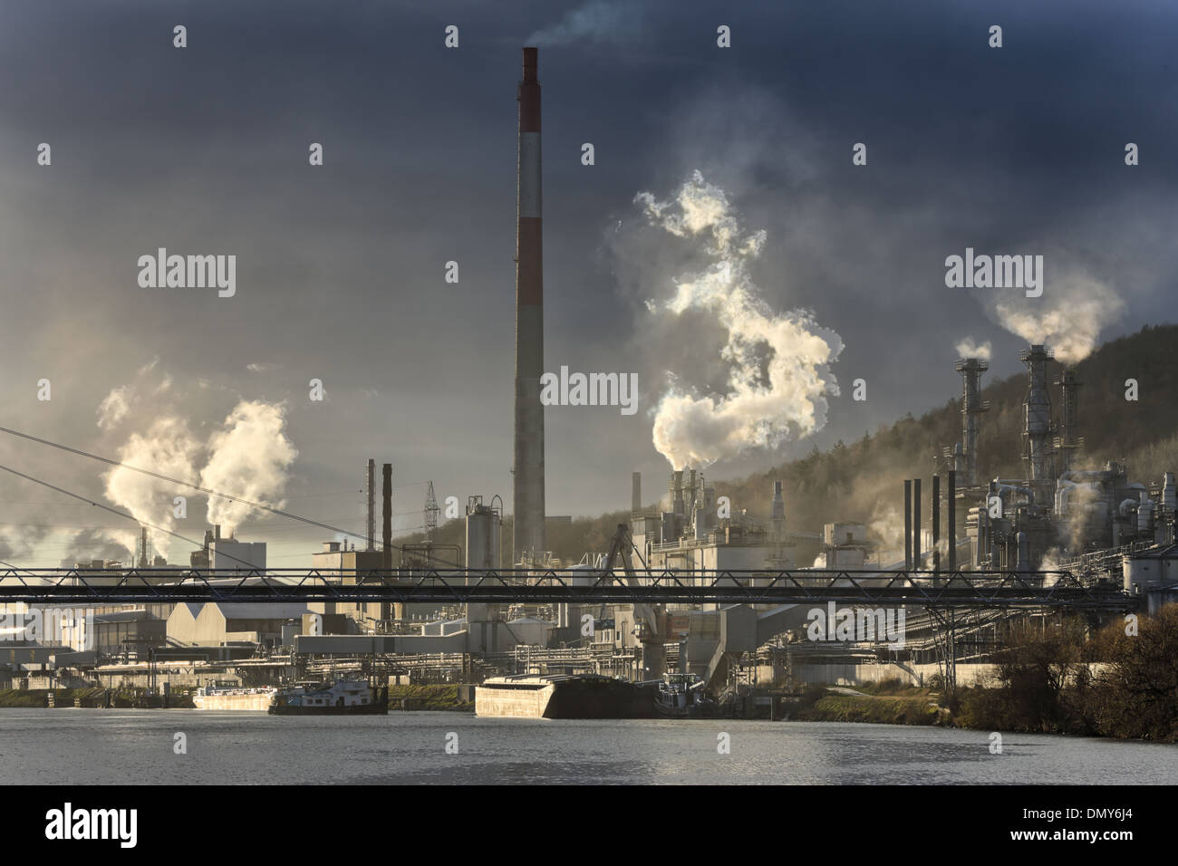 Chemical industries generating pollution. Some chimneys with smoke. Landscape and nobody - Stock Image