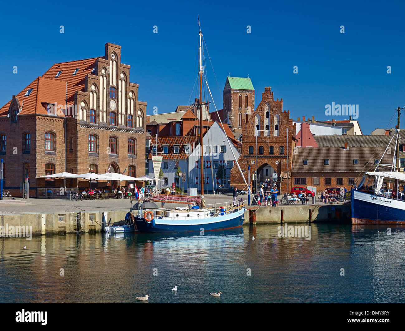 Old Harbour with Wassertor and Church of St. Nicholas, Wismar, Mecklenburg-Vorpommern, Germany Stock Photo
