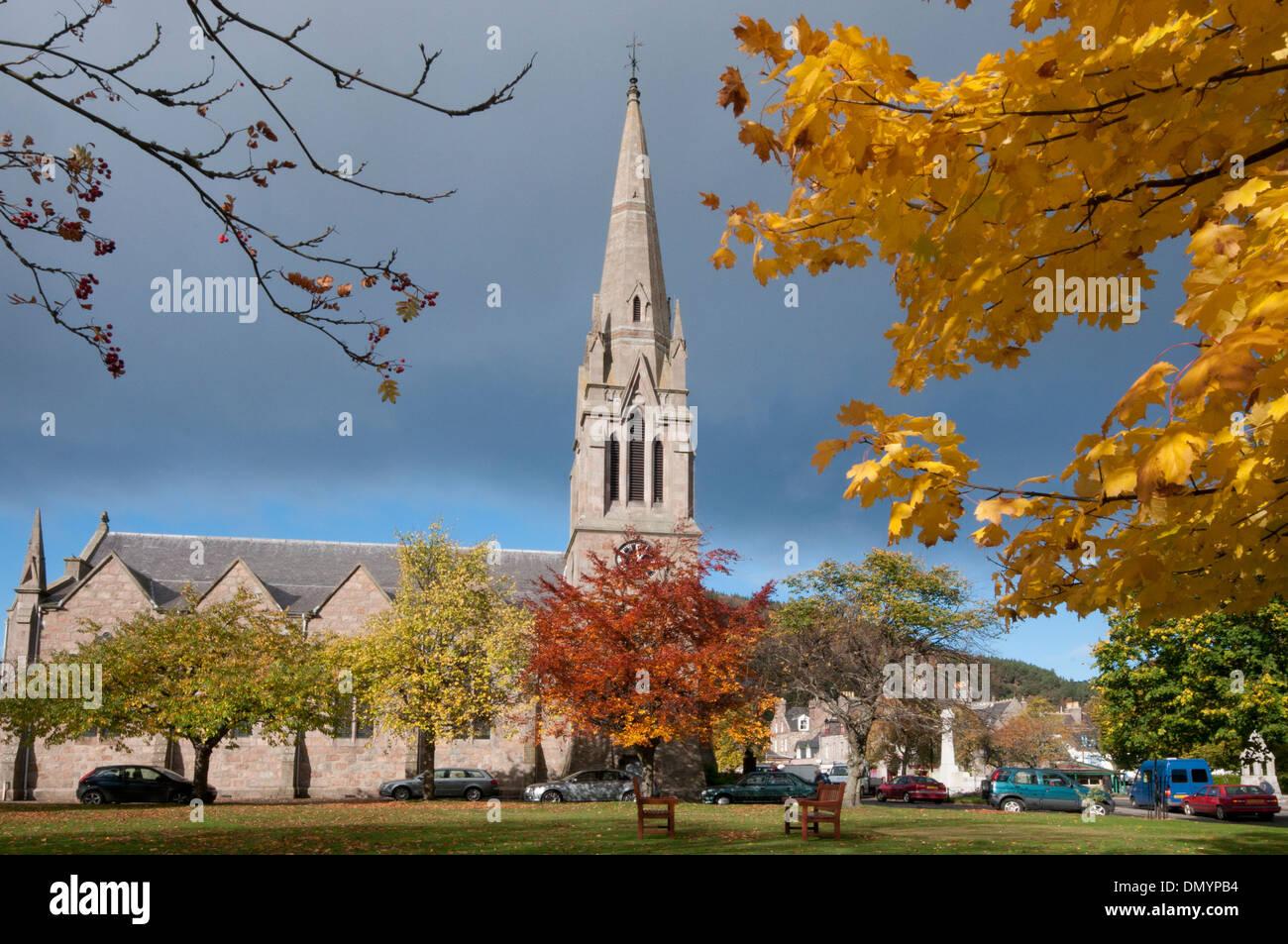 ballater church spire in autumn colour at glenmuick church - Stock Image