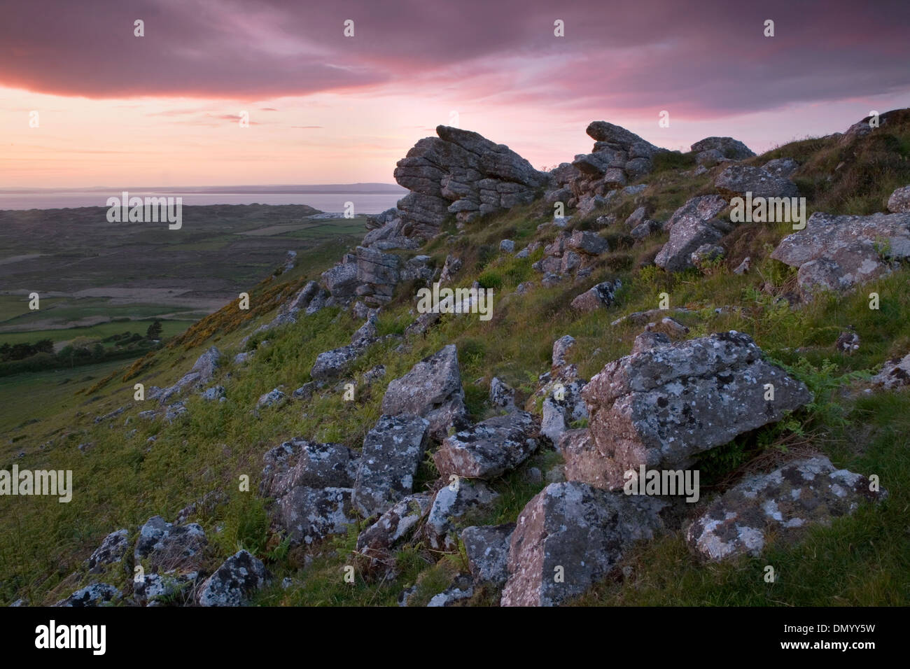 The last light of day lingers over the moorland near Llangennith and Rhossili Bay, Gower Peninsula, South Wales. Stock Photo