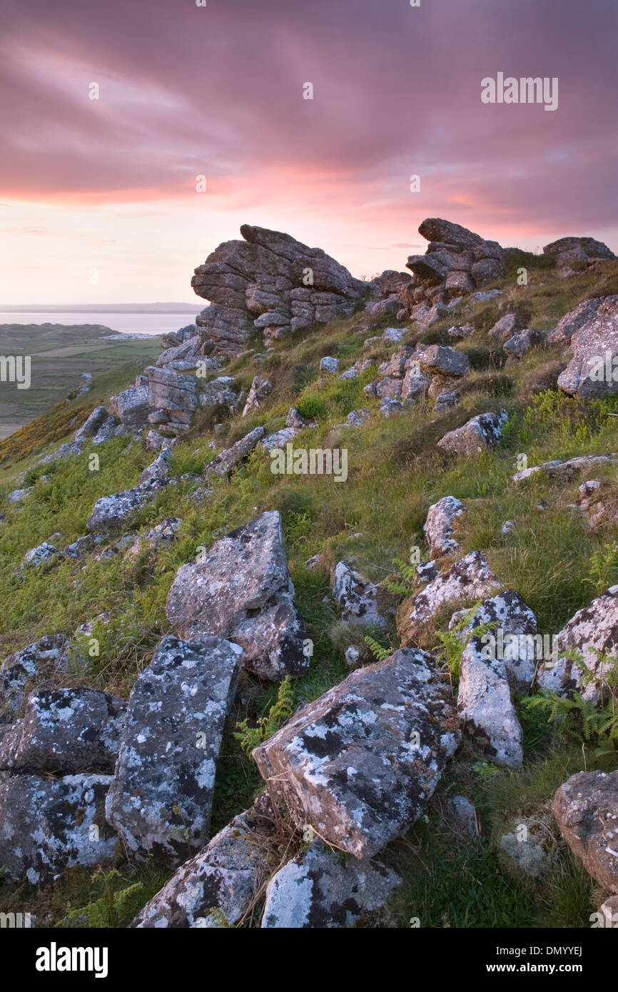 Boulders on the ridge of Rhossili Down near Llangennith, Gower Peninsula, overlook Rhossili Bay at sunset. Stock Photo