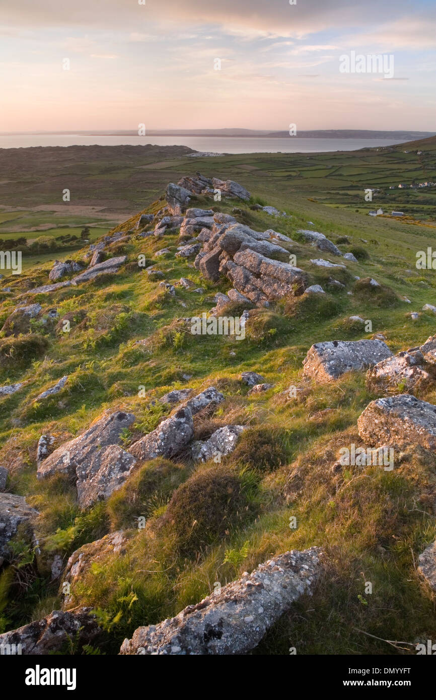 Boulders on the ridge of Rhossili Down near Llangennith, Gower Peninsula, overlook Rhossili Bay at sunset. Stock Photo