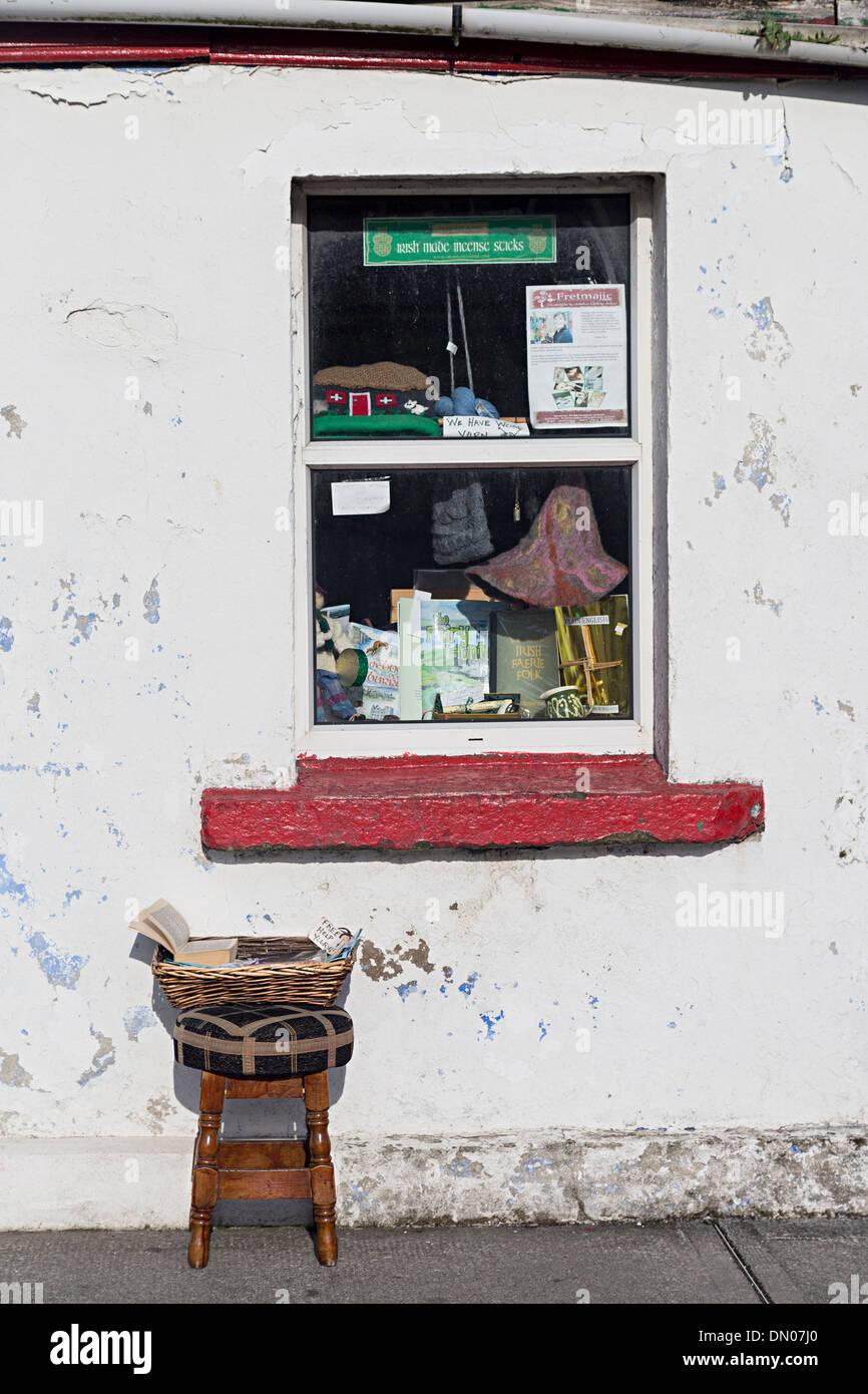 Window and stool outside shop, Doolin, Co. Clare, Ireland - Stock Image