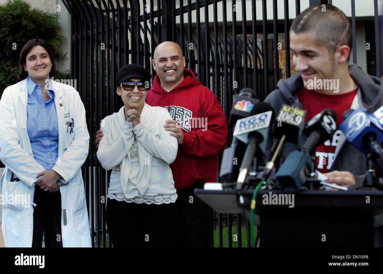 Dec 23, 2009 - San Jose, California - While MATT BLEA, right, makes a statement to journalists, his parents, JANE Stock Photo