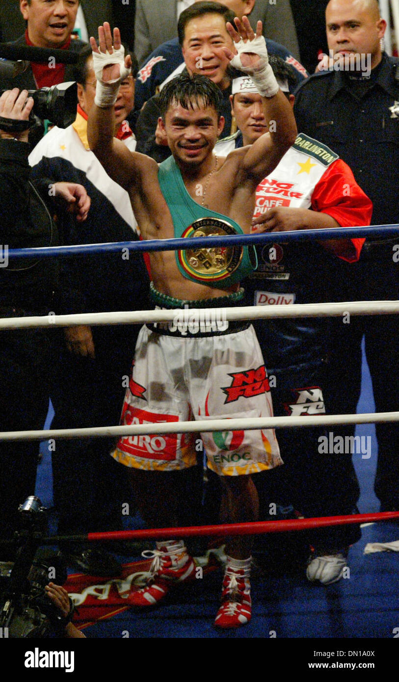 Jan 21, 2006; Las Vegas, NV, USA; MANNY PACQUIAO of the Philippines, celebrates after stopping Erik Morales in the 10th round to win the super featherweight boxing match Saturday night. Mandatory Credit: Photo by J.P. Yim/ZUMA Press. (©) Copyright 2006 by J. P. Yim Stock Photo