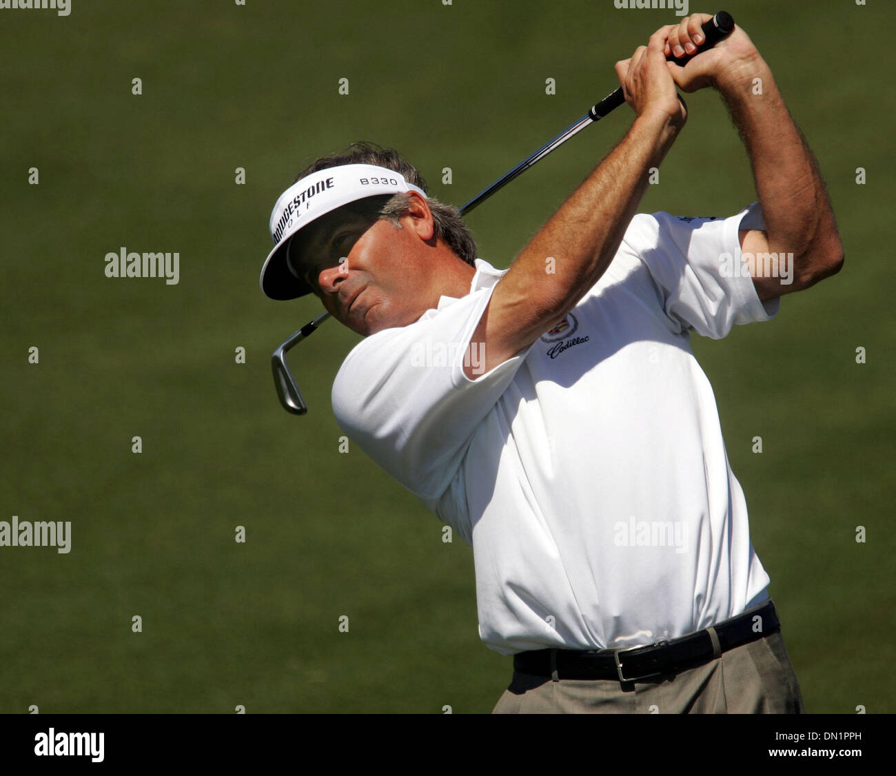 The Honda Classic started Wednesday with Pro-Am tournaments at The Country Club at Mirasol in Palm Beach Gardens. FRED COUPLES hits the ball from the field at the 18th hole Wednesday morning in the 2006 Honda Classic Pro-Am Tournament. - Stock Image
