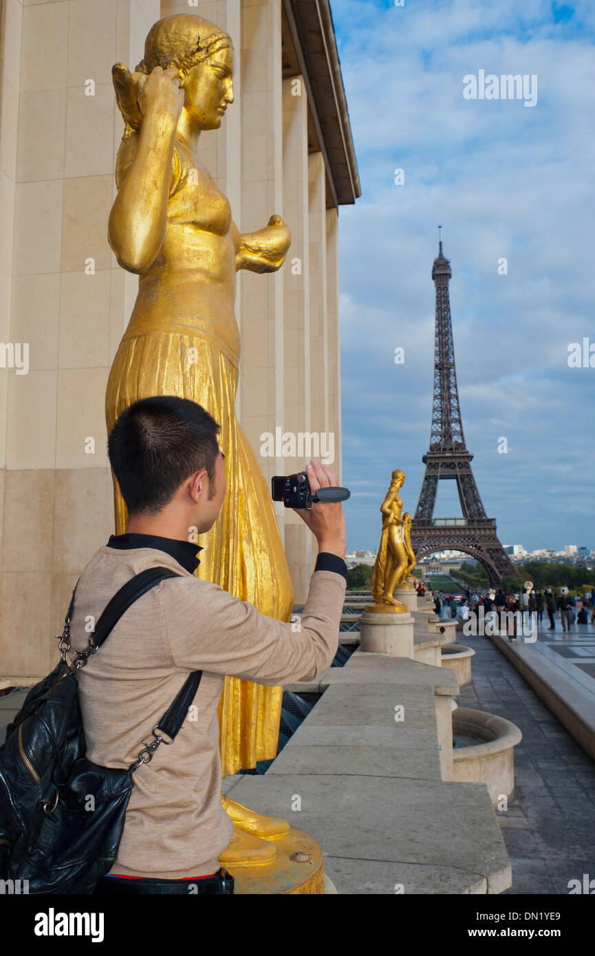 Paris, France, Young Chinese Man, Tourist, Standing near Eiffel Tower, Taking Photos Stock Photo