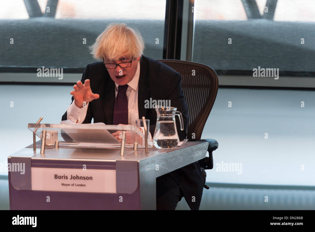 London, UK. 18th December, 2013. Boris Johnson attempted to answer questions on several issues at the Mayor's Question Time at City Hall, London, including safer cycling, fuel poverty, tackling FGM and his recent IQ test on LBC. Credit:  Lee Thomas/Alamy Live News - Stock Image