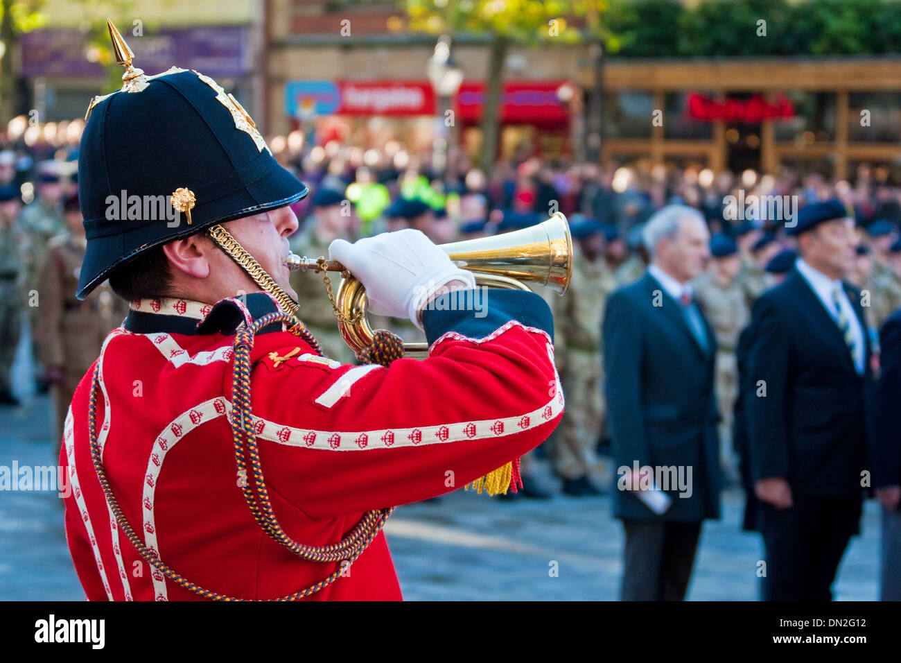 Bugler sounds the Last Post at the 2013 Remembrance Sunday Parade in Preston, Lancashire - Stock Image