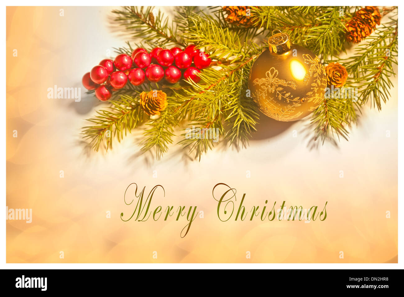 Merry Christmas card, with Christmas decorations, soft background lights and text. Room for more text. - Stock Image