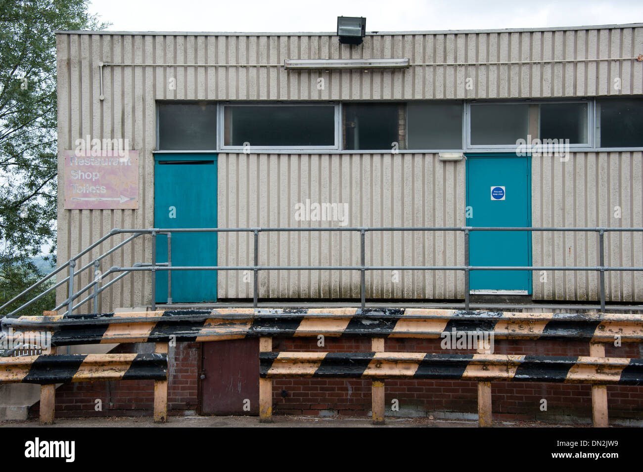 Dull Grey depressing factory doors - Stock Image