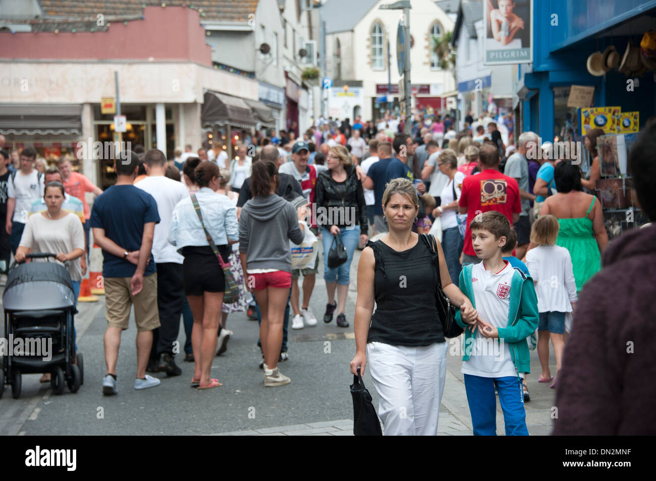 Crowded streets tourists Newquay Cornwall - Stock Image