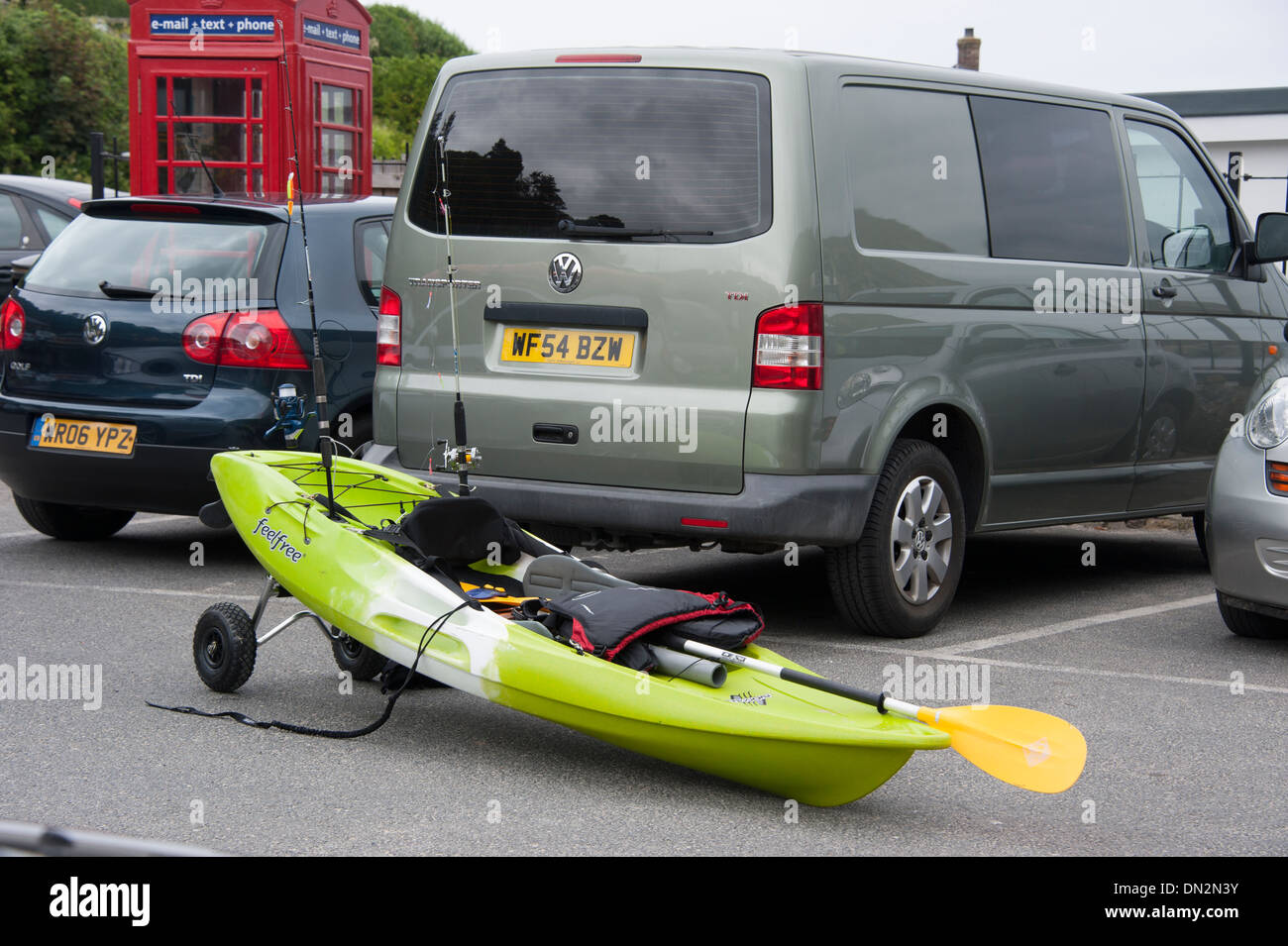 Surfers canoe Boat by VW van on wheels fishing - Stock Image