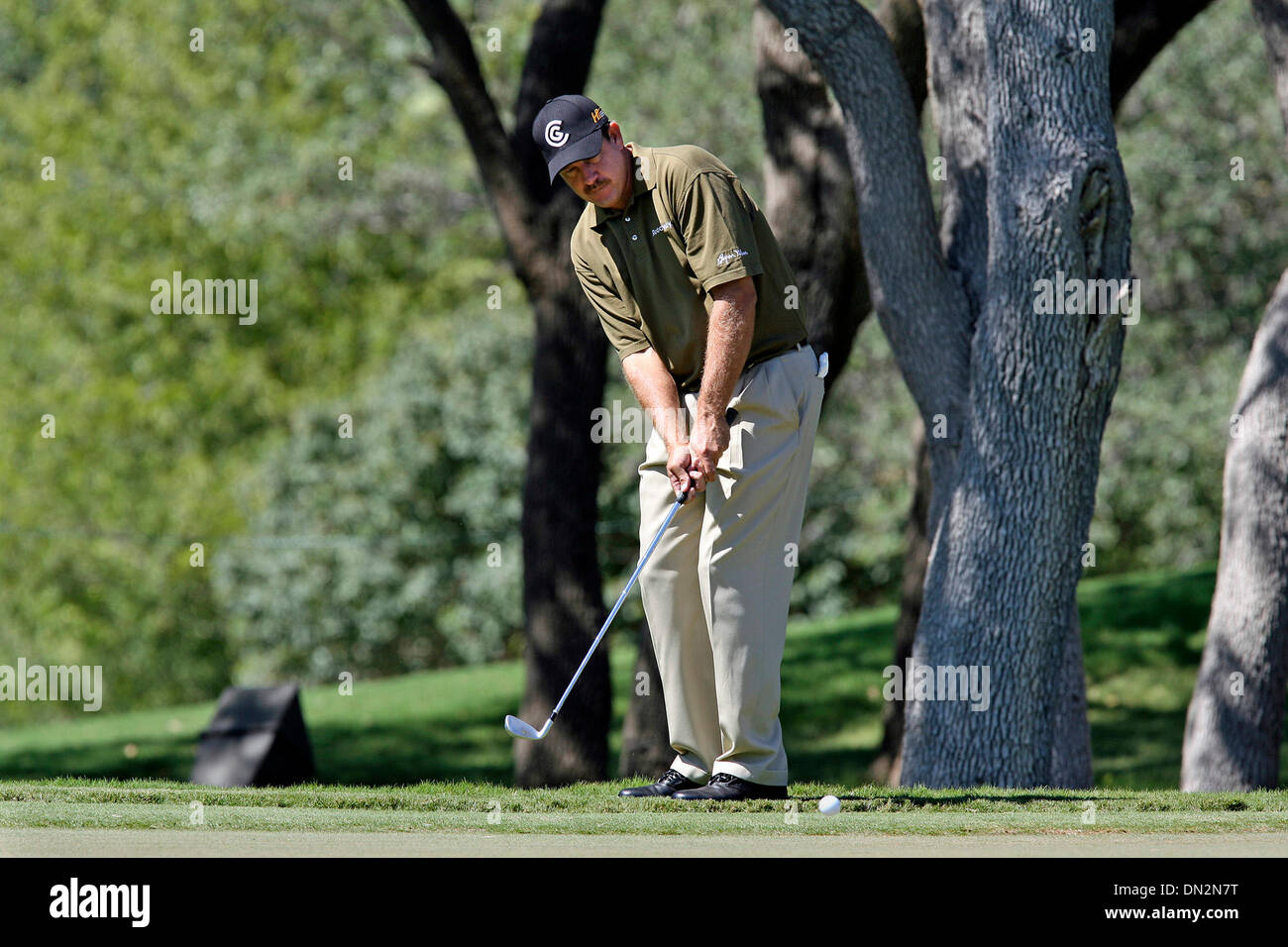Sep 20, 2006; San Antonio, TX, USA; GOLF: Past Texas Open champion BART BRYANT bumps his ball back up on the putting surface at 17 Wednesday during the Valero Texas Open Pro Am. Mandatory Credit: Photo by Tom Reel/San Antonio Express-News/ZUMA Press. (©) Copyright 2006 by San Antonio Express-News - Stock Image