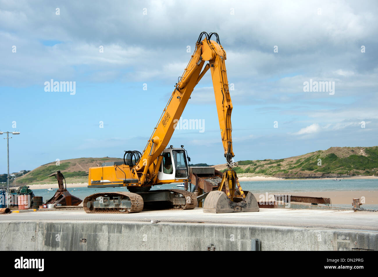 JCB Digger on Dockside Padstow Cornwall - Stock Image